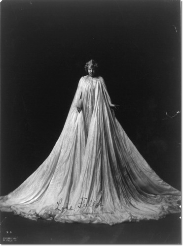 loie-fuller-full-length-portrait-standing-facing-front-draped-in-very-long-gown