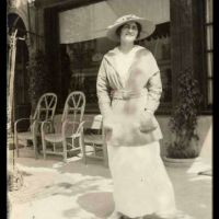 Coco Chanel in front of the first Chanel store (1913)