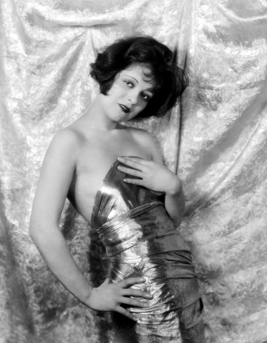 1926: Hollywood film star, Clara Bow (1905 - 1965) in a shiny strapless dress. (Photo by Eugene Robert Richee)