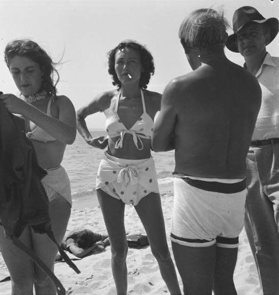 Photograph of Dora Maar, Nusch ?luard, Pablo Picasso and Paul ?luard on the beach September 1937 by Eileen Agar 1899-1991