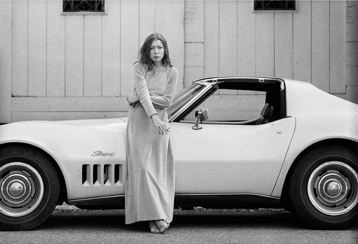 Joan Didion in Front of Her Yellow Stingway by Julian Wasser (1972)