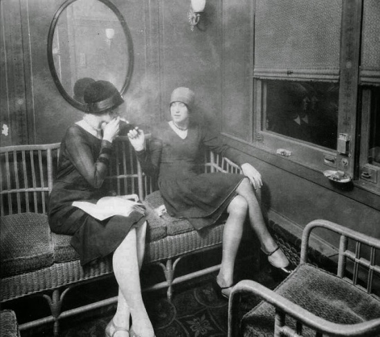 flappers-smoking-cigarettes-in-a-train-car-ca-1920s